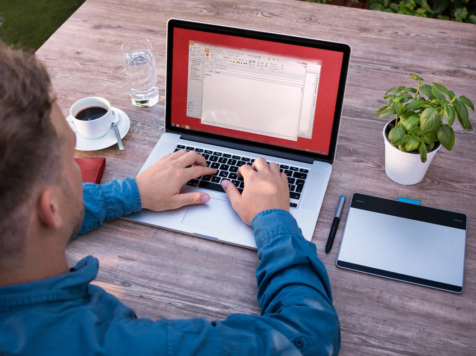 Man sitting on a laptop an using RMail.