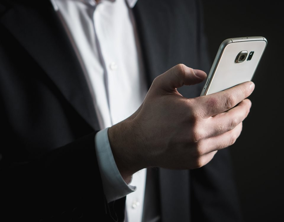 A businessman with his smartphone in his hand
