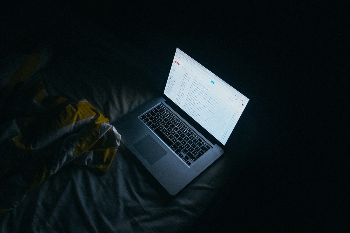 Laptop in a dark room.