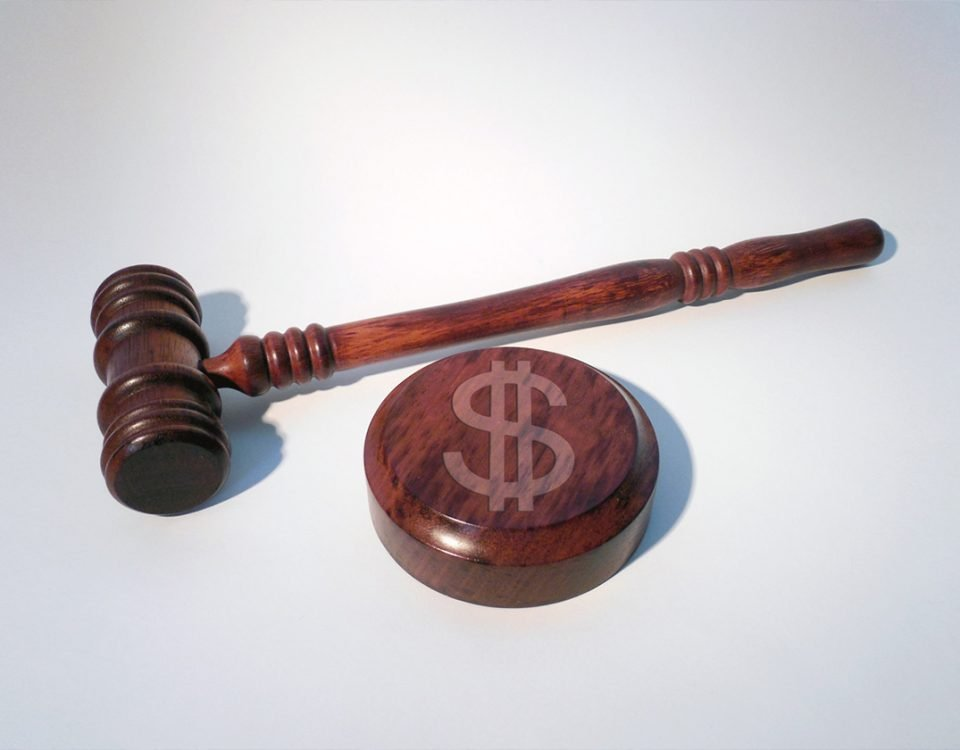 Judge's Hammer with US Dollar Mark as a fine for data breaches